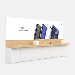 mobile phone retail display counter against wall